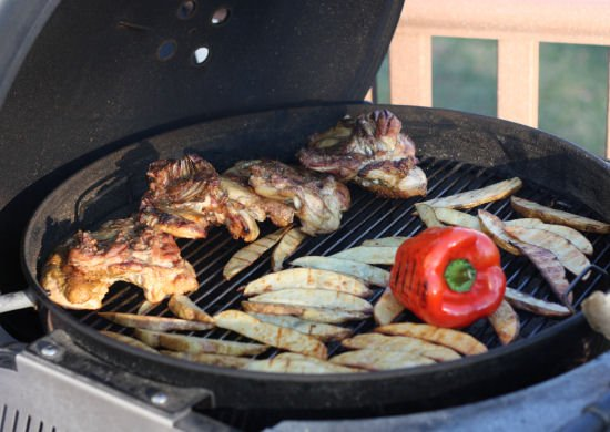 Loaded grill with french fries, grilled chicken and red pepper