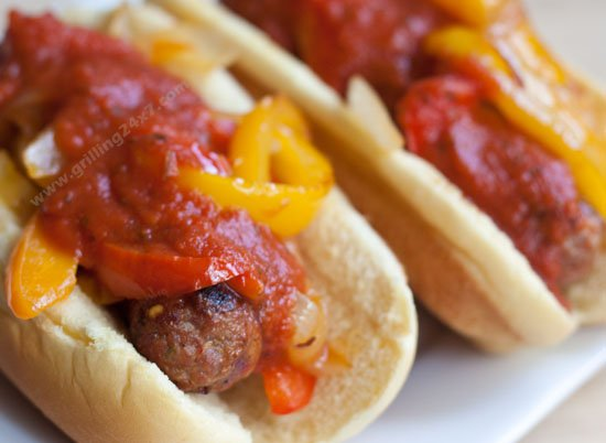 Sausage sandwich grilled on an extra grill grate added to a grill