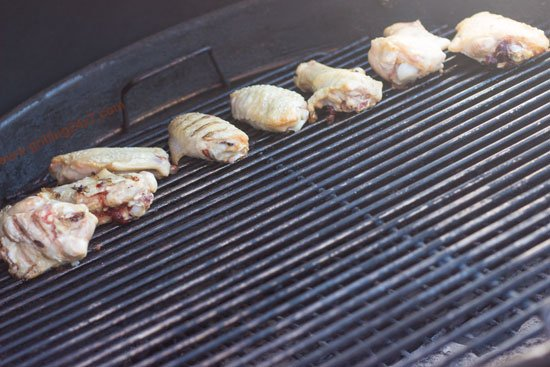 Grilling chicken wings on the grill