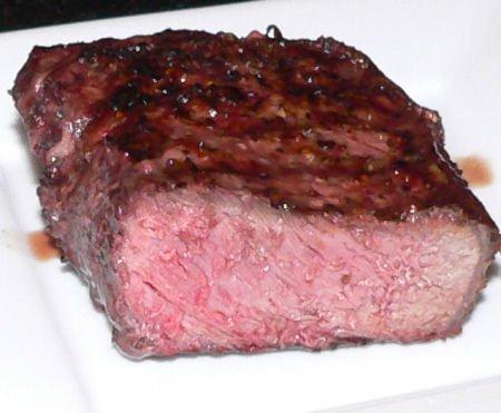 a new york strip steak cooked medium