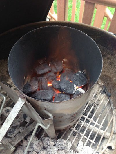 How to light a pit barrel cooker using charcoal and lighter fluid or a charcoal chimney - grilling24x7.com