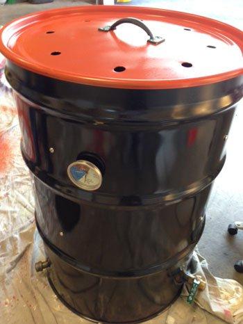 Baltimore Orioles and Baltimore Ravens themed smoker ugly drum smoker