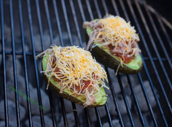 Grilled stuffed avocado recipe with pulled pork, salsa and cheese - Grilling24x7.com