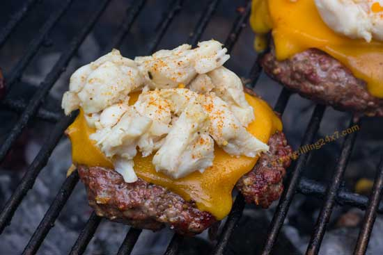 Jumbo Lump Crab Burger Recipe - Lump crab meat with Old Bay on top of a juicy charcoal grilled cheeseburger.